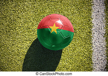 football ball with the national flag of burkina faso lies on...