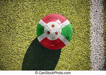 football ball with the national flag of burundi lies on the...