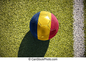 football ball with the national flag of chad lies on the...