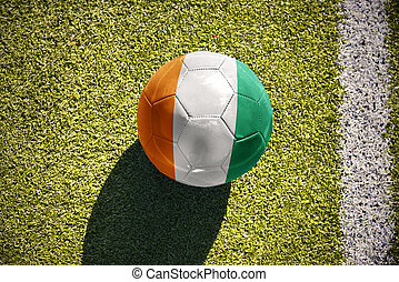 football ball with the national flag of cote divoire lies on...