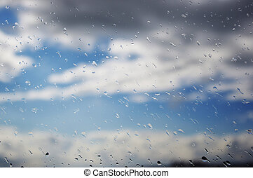 Raindrops on window - Close-up of a windowpane covered with...
