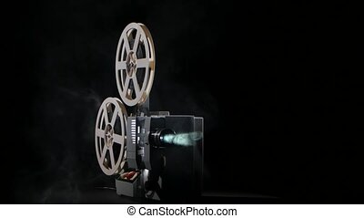 On the background of a working film projector smoke, revolve...