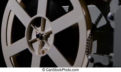 Projector that turns the film reel. Side view - Projector...