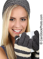 Lady in Woolen Gloves and Hat Keeping Warm - Lovely blond...