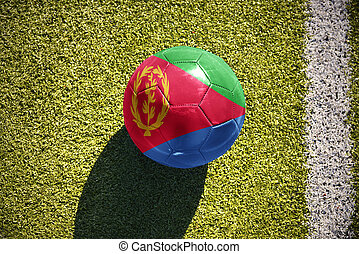 football ball with the national flag of eritrea lies on the...
