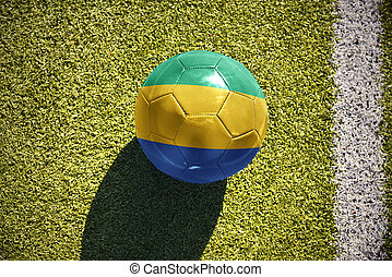 football ball with the national flag of gabon lies on the...