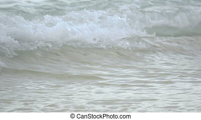 Rolling wave close-up, slow motion - Turquoise waves rolled...