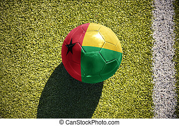 football ball with the national flag of guinea bissau lies...