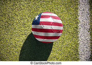 football ball with the national flag of liberia lies on the...