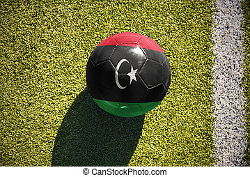 football ball with the national flag of libya lies on the...