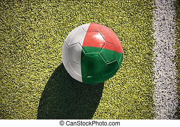 football ball with the national flag of madagascar lies on...