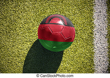 football ball with the national flag of malawi lies on the...