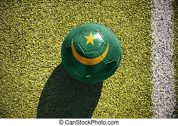 football ball with the national flag of mauritania lies on...