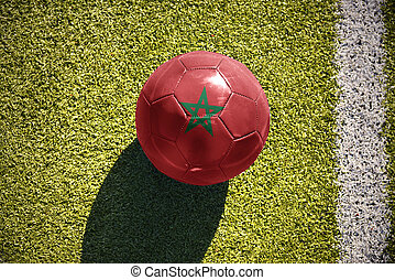 football ball with the national flag of morocco lies on the...