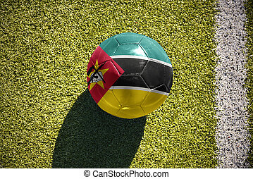 football ball with the national flag of mozambique lies on...