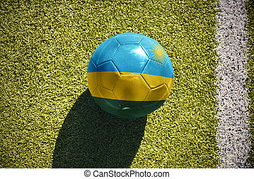 football ball with the national flag of rwanda lies on the...