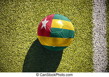 football ball with the national flag of togo lies on the...