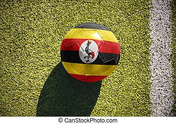 football ball with the national flag of uganda lies on the...