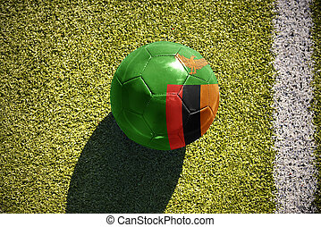football ball with the national flag of zambia lies on the...