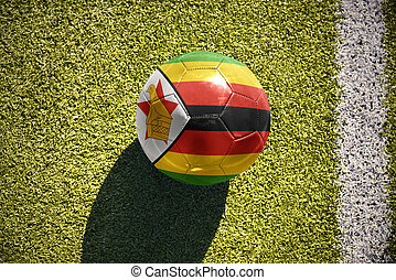 football ball with the national flag of zimbabwe lies on the...