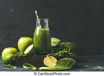 Smoothie with apple, romaine lettuce, lime, mint, dark blue...