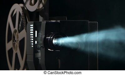 Close up of a vintage movie projector. Projection rays -...