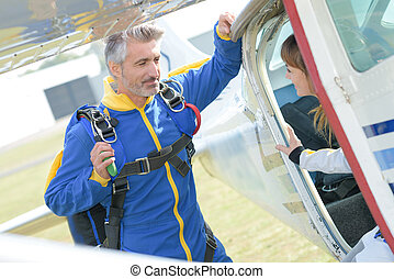 skydiver talking to a client