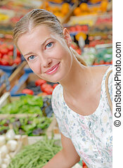 Smiling lady in greengrocers