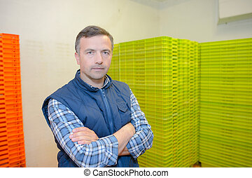 man posing with crates