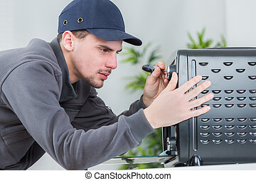 Young man repairing household appliance