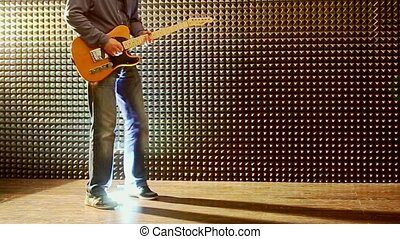 Guy Plays Guitar at Rehearsal in Studio Man Sets Bright...