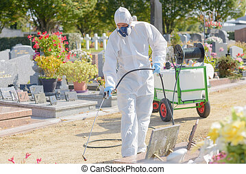 industrial cleaner sterilising graveyard with high pressure...