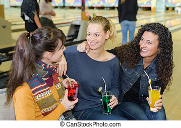 friends in the bowling center