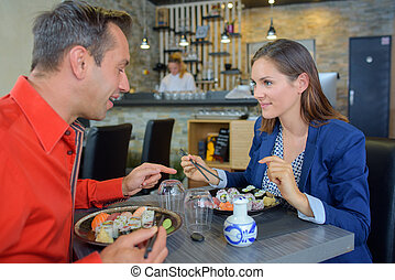 Couple eating in sushi restaurant