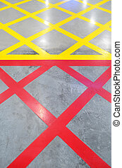 No parking red and yellow cross zone, criss-cross painted on...