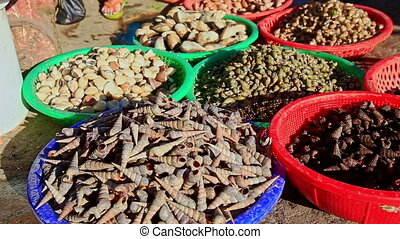 Various Products in Basins at Street Market in Vietnam -...