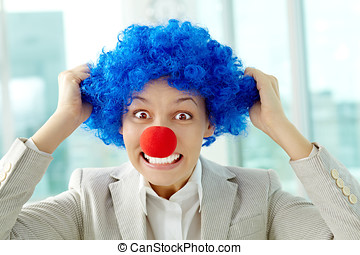 Office fool in clown wig - Portrait of female manager in...