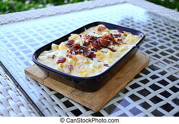 Baked macaroni with cheese and bacon