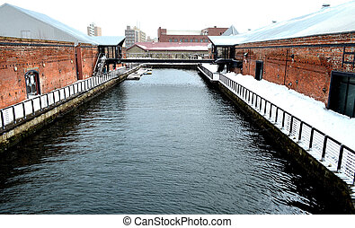 Canal between red brick warehouse in winter, Hakodate, Japan...