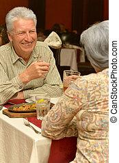 senior couple in restaurant, having romantic dinner