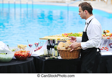 buffet serve - young people serving food on buffet wedding...