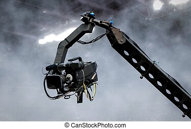 Camera on crane shooting in a stadium