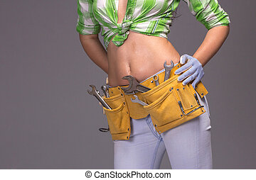 Female Construction Worker With Tool belt.