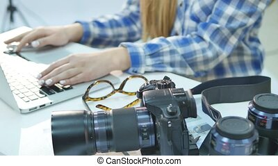 Female photographer working in her studio hands close up and...