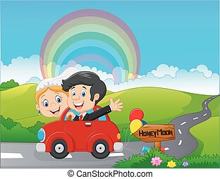 Just married couple driving a car in honeymoon trip
