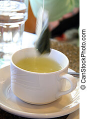 Green Tea in a Mug - Taking a Green Tea Bag out of Mug