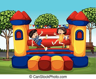Two kids bouncing on the rubber house