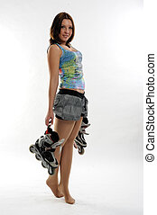 Young pretty woman with roller skates - Young attractive...