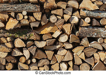 Background of firewood stack - Close up of firewood stack...
