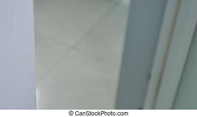 white door handle open close-up - white Door handle open...